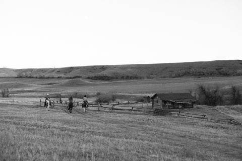 Madison McKinley team riding into dusk on the Steerhead Ranch.