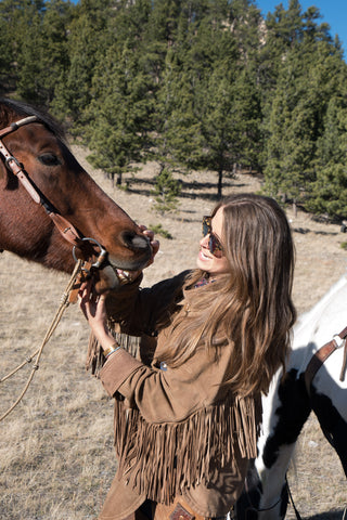 Madison McKinley on the ranch with her horse.