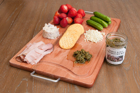 Charcuterie board with Pablo Kim's fresh Chimichurri