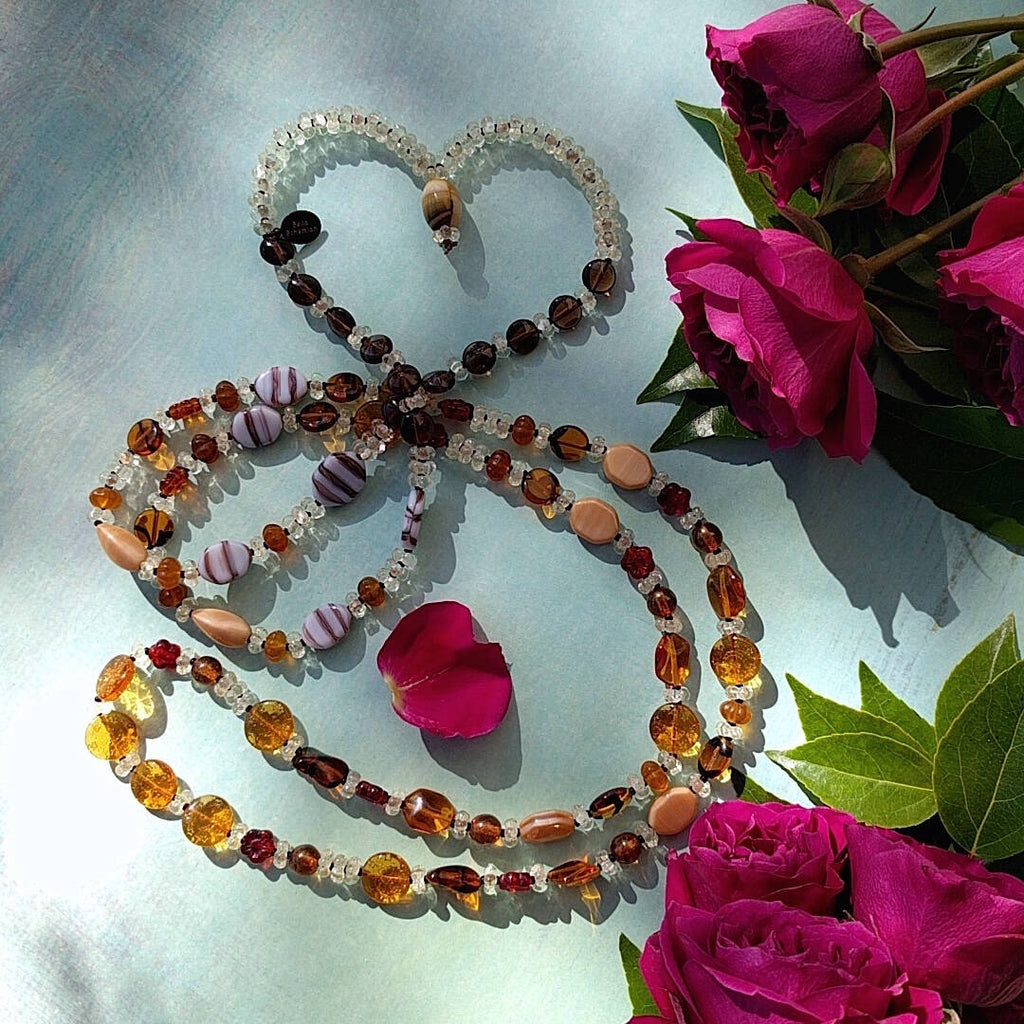 amber boho beauty necklace partially laid out like a heart