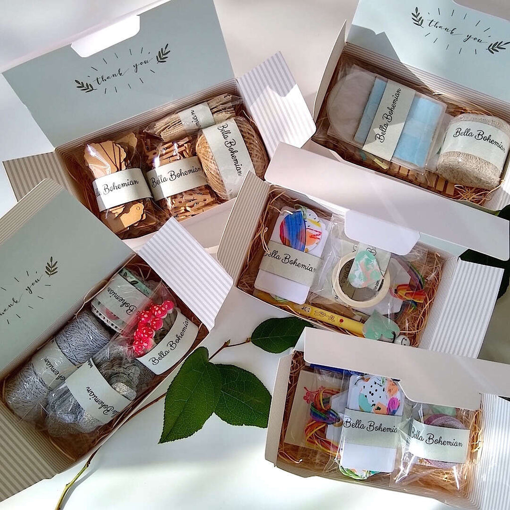 five papeterie or stationery kits in their gift boxes