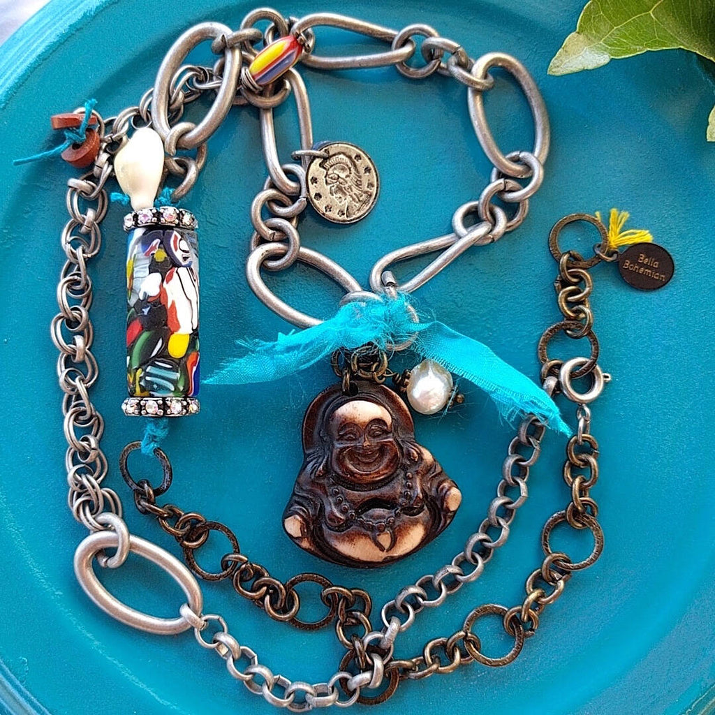 handmade mixed-metal necklace with hand carved happy buddha