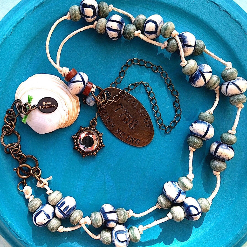 African and Tibetan beads necklace with carved donut shaped bones