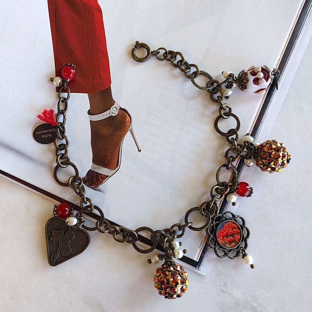 bracelet with charms including brass heart, red round glass, flower frame with red tulips image, round colorful balls and happy white buddha