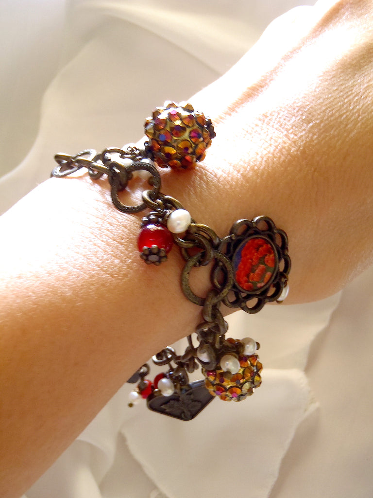bracelet with charms including brass heart as seen worn on lady's wrist