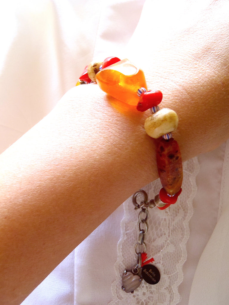 handmade bracelet on black waxed thread with African amber beads shown on a lady's wrist