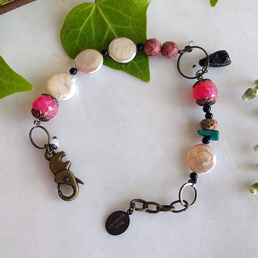 handmade bracelet with faceted pink agate, coin pearls, round black jasper, fancy brass caps, turquoise chips, and faceted brown jade