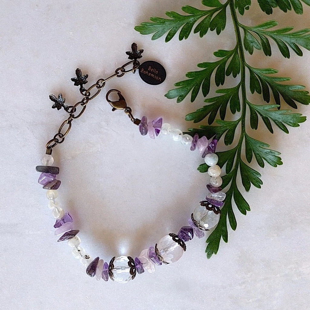 handmade bracelet using small irregular amethyst chips with translucent accent beads, medium round faceted glass beads and fancy brass caps