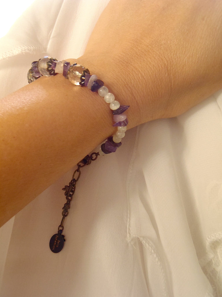 handmade bracelet using small irregular amethyst chips shown as worn on a lady's wrist