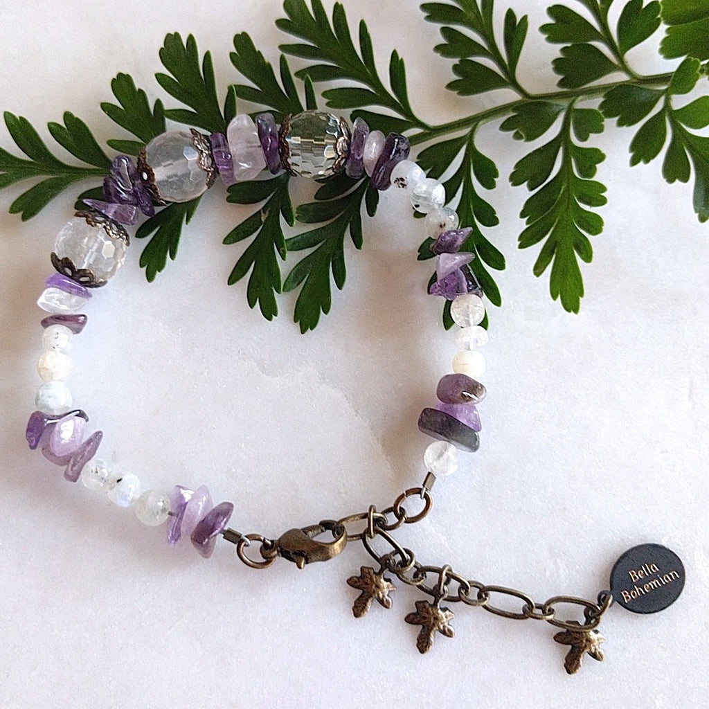 handmade bracelet using small irregular amethyst chips with translucent accent beads, medium round faceted glass beads on alternate background
