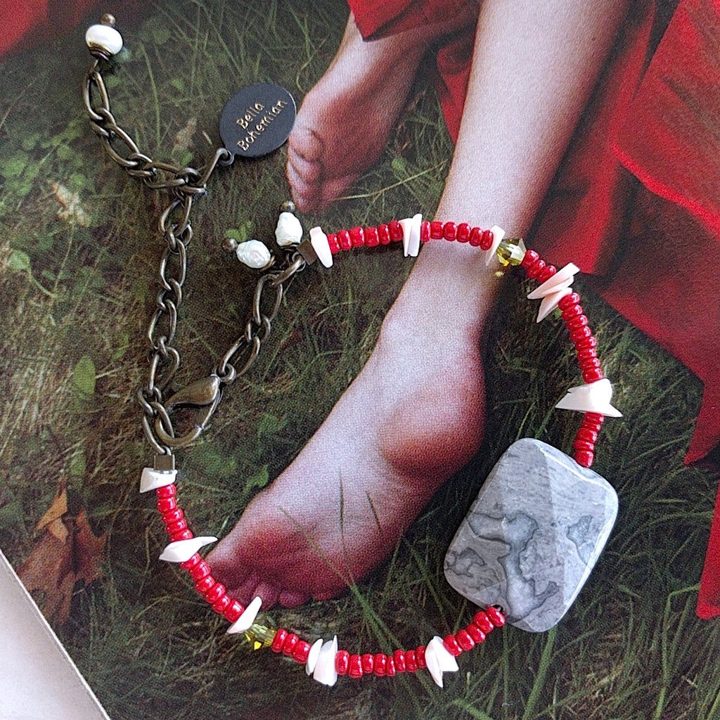 handmade friendship bracelet with red Indian seed beads, white coral chips, tiny green Swarovski beads
