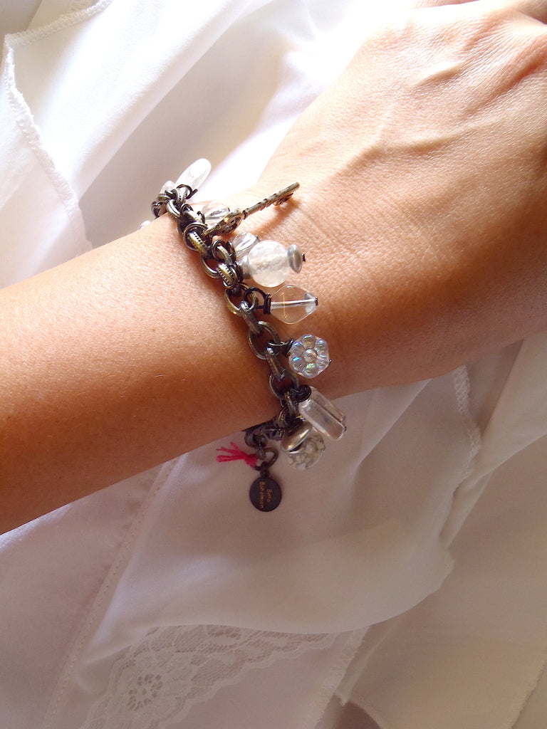 handmade bracelet with white translucent glass charms seen on a lady's wrist