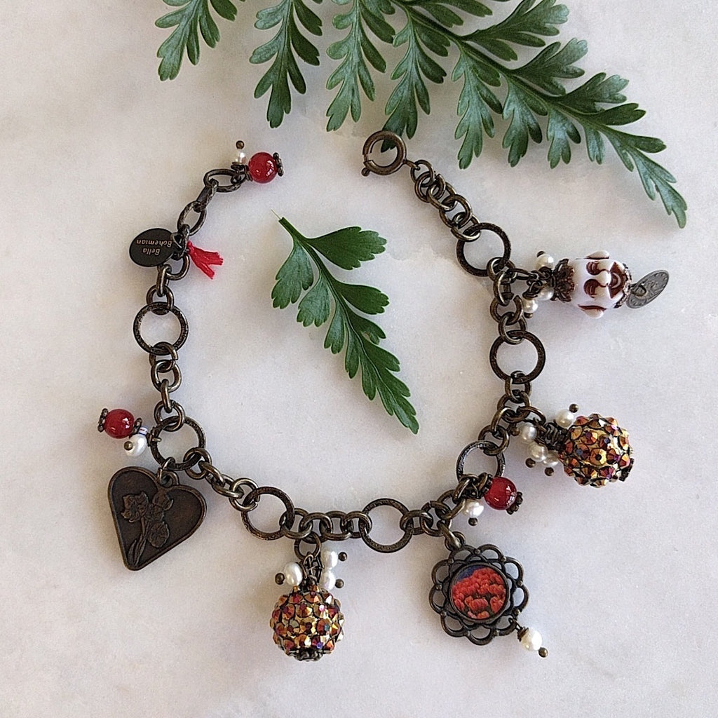 bracelet with charms including brass heart, red round glass, flower frame with red tulips image, round colorful balls and happy white buddha with mini coin