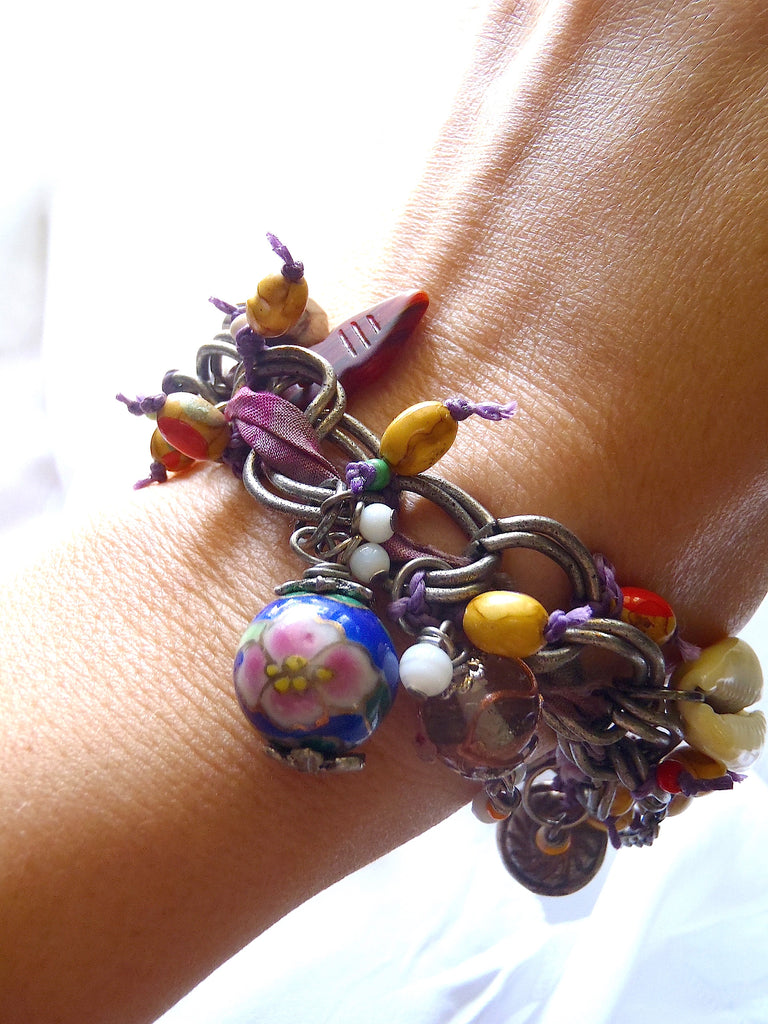 handmade bracelet with dyed dark and light purple sari silk seen on a lady's wrist