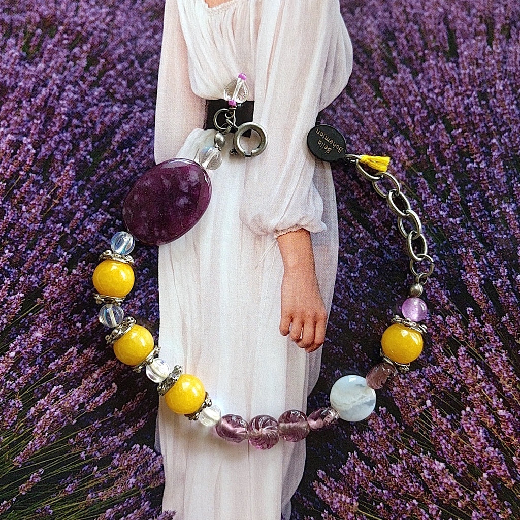 braclet with combination of yellow jade, purple glass beads, clear Czech glass beads