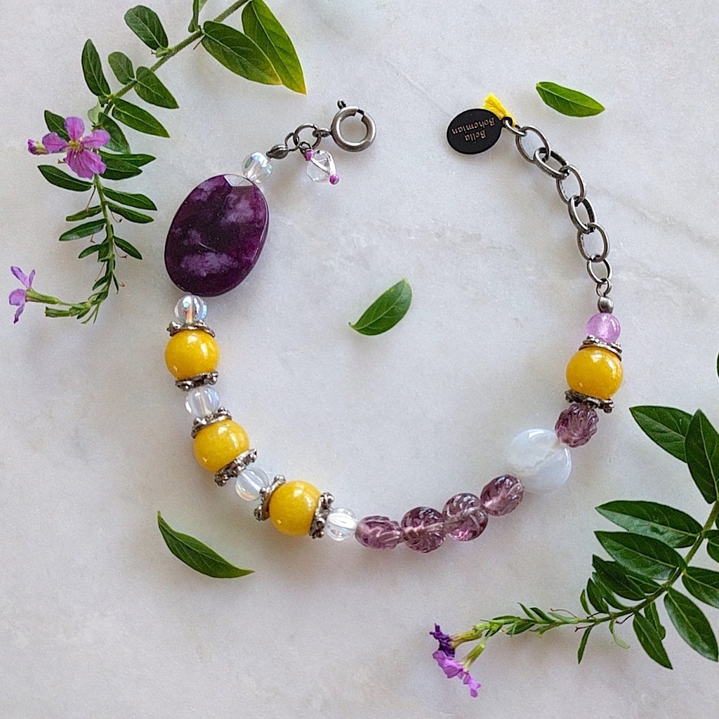 braclet with combination of yellow round jade, purple glass bead, clear Czech glass beads, a large faceted purple amethyst