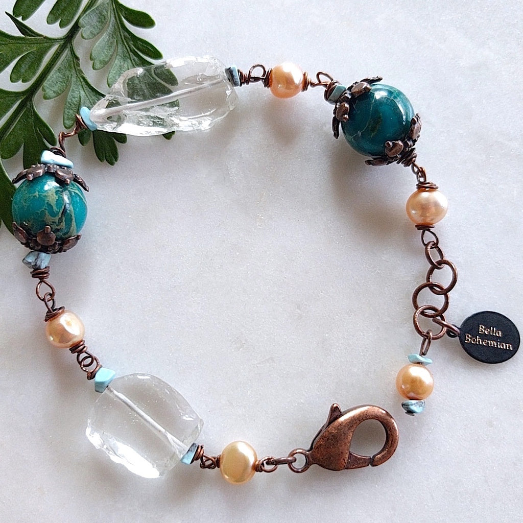 bracelet with creme color fresh water pearls, irregular glass beads, dyed serpentine jasper aqua round beads