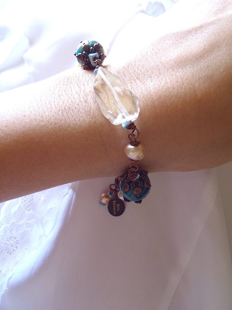bracelet with fresh water pearls, irregular glass beads, dyed serpentine jasper aqua round beads shown on a lady's wrist