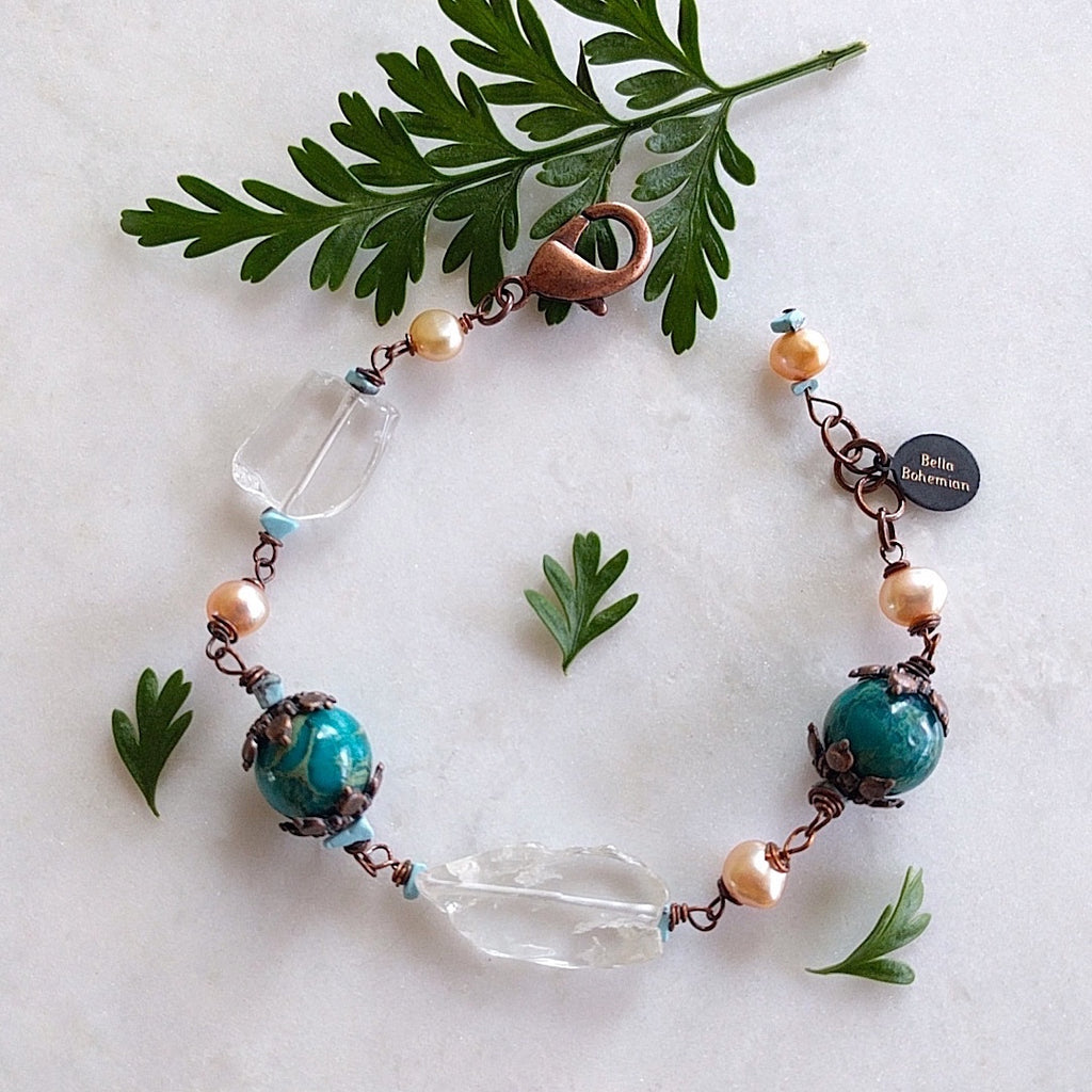bracelet with creme color fresh water pearls, irregular glass beads, dyed serpentine jasper aqua round beads, copper caps and turquoise chips