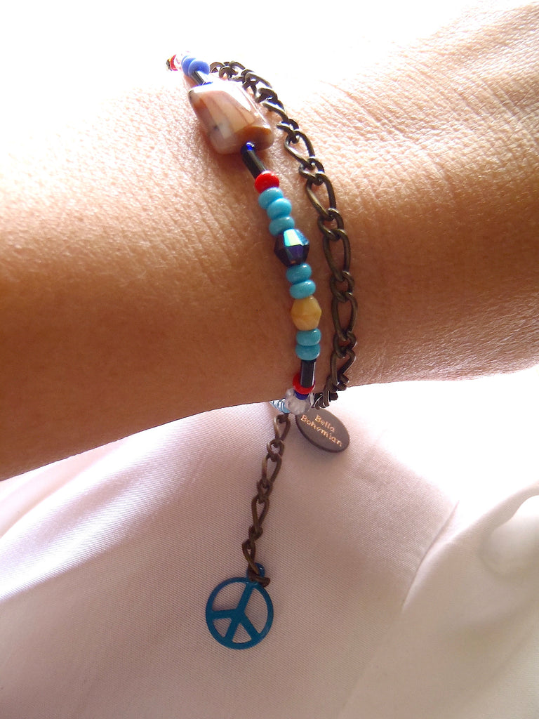 handmade friendship bracelets with colors of blue red amber and clear beads on a lady's wrist