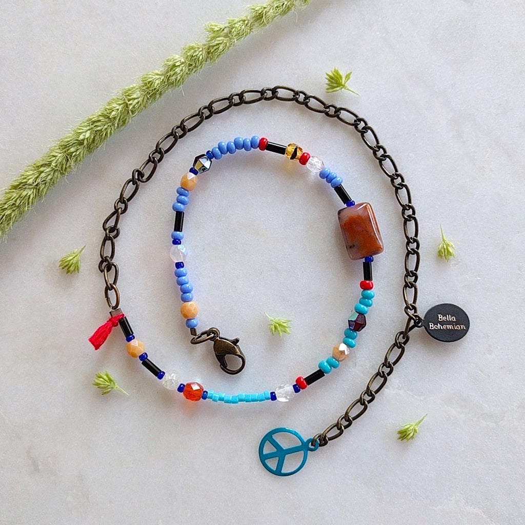 handmade friendship bracelets with colors of blue red amber and clear beads