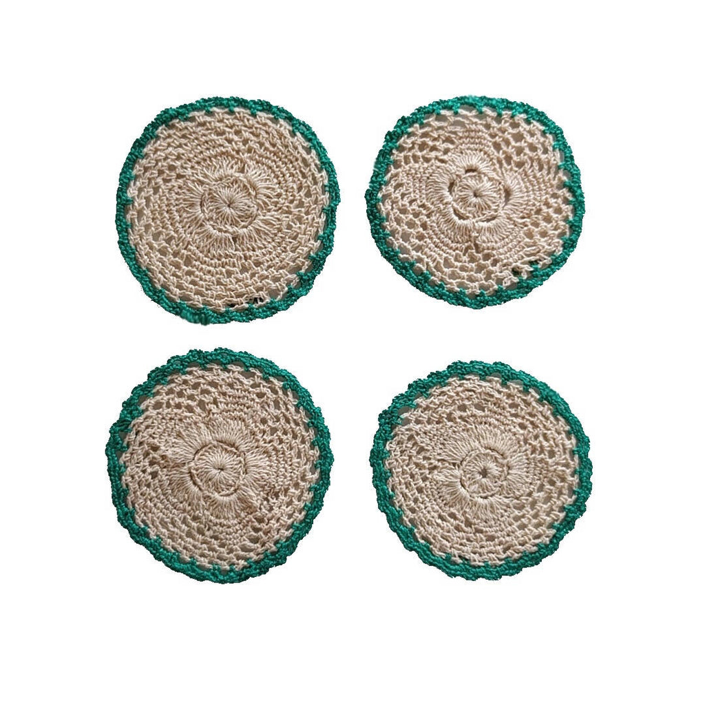 set of four round crochet cotton yarn coasters in tan color and teal border - plain image