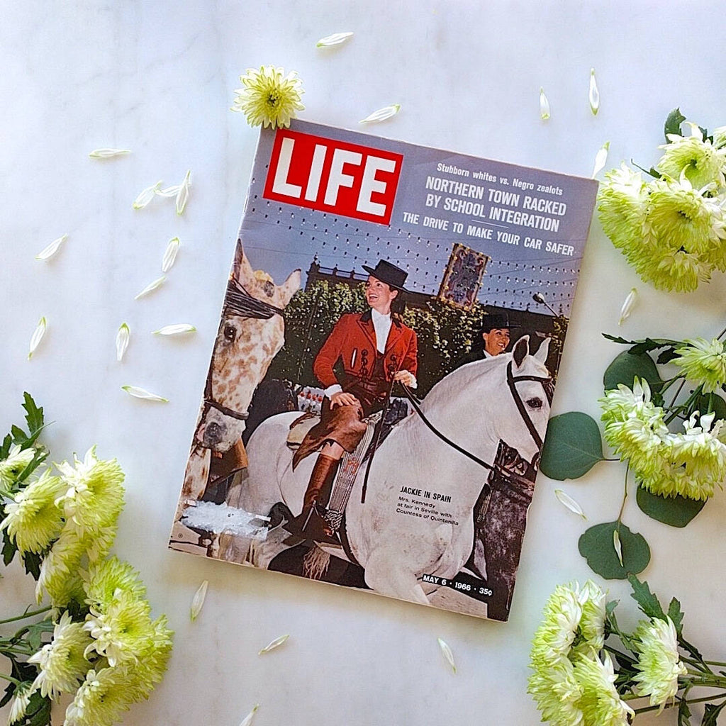 life magazine from may 1966 showing Jacqueline Kennedy on a white horse