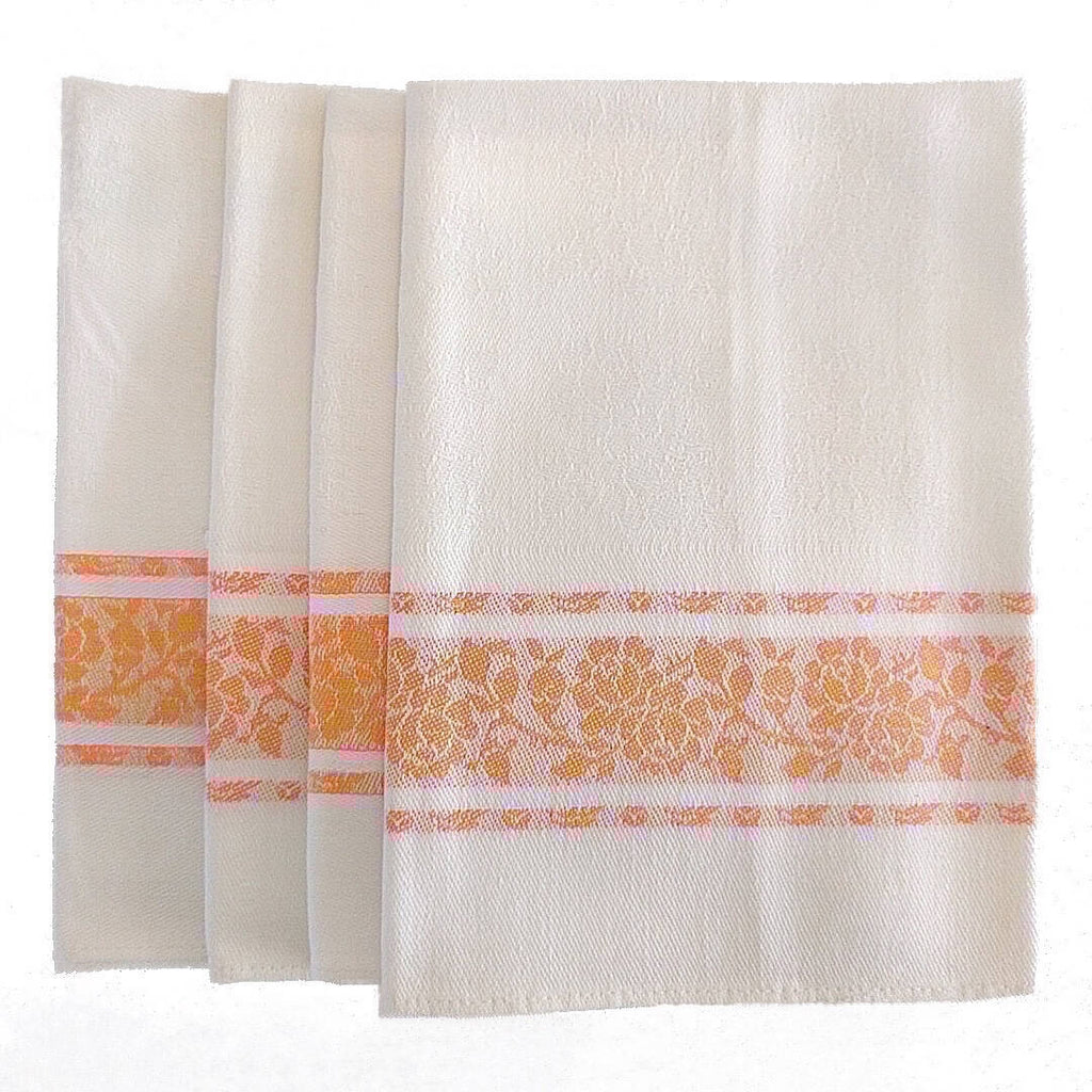 set of four white cotton napkins with orange detail and flower pattern