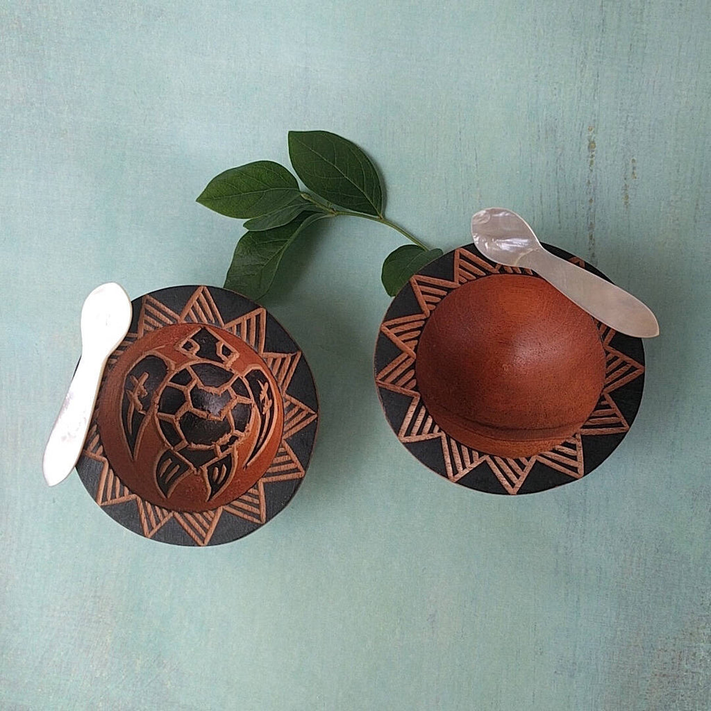 hand carved Fijian light wood salt and pepper cellars with turtle and sun designs