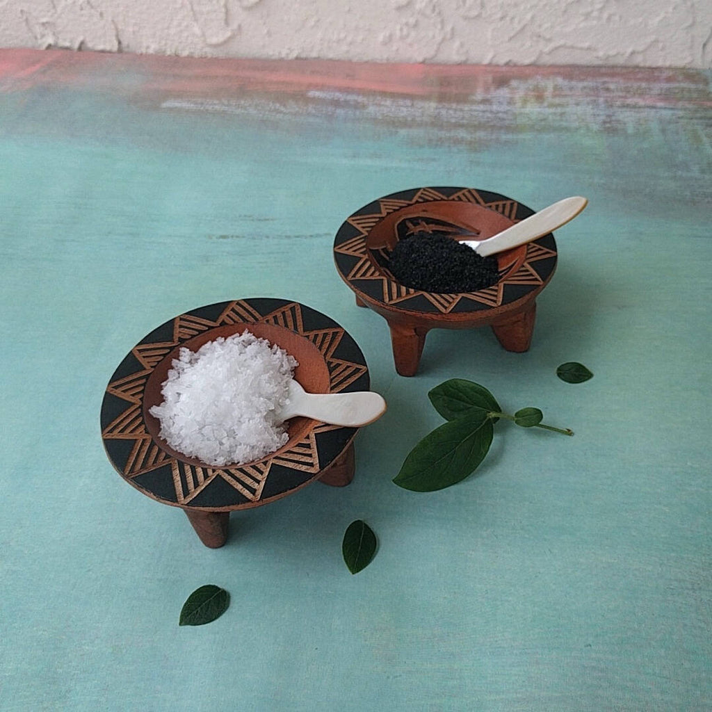 hand carved Fijian light wood salt and pepper cellars shown with salt and pepper - side view