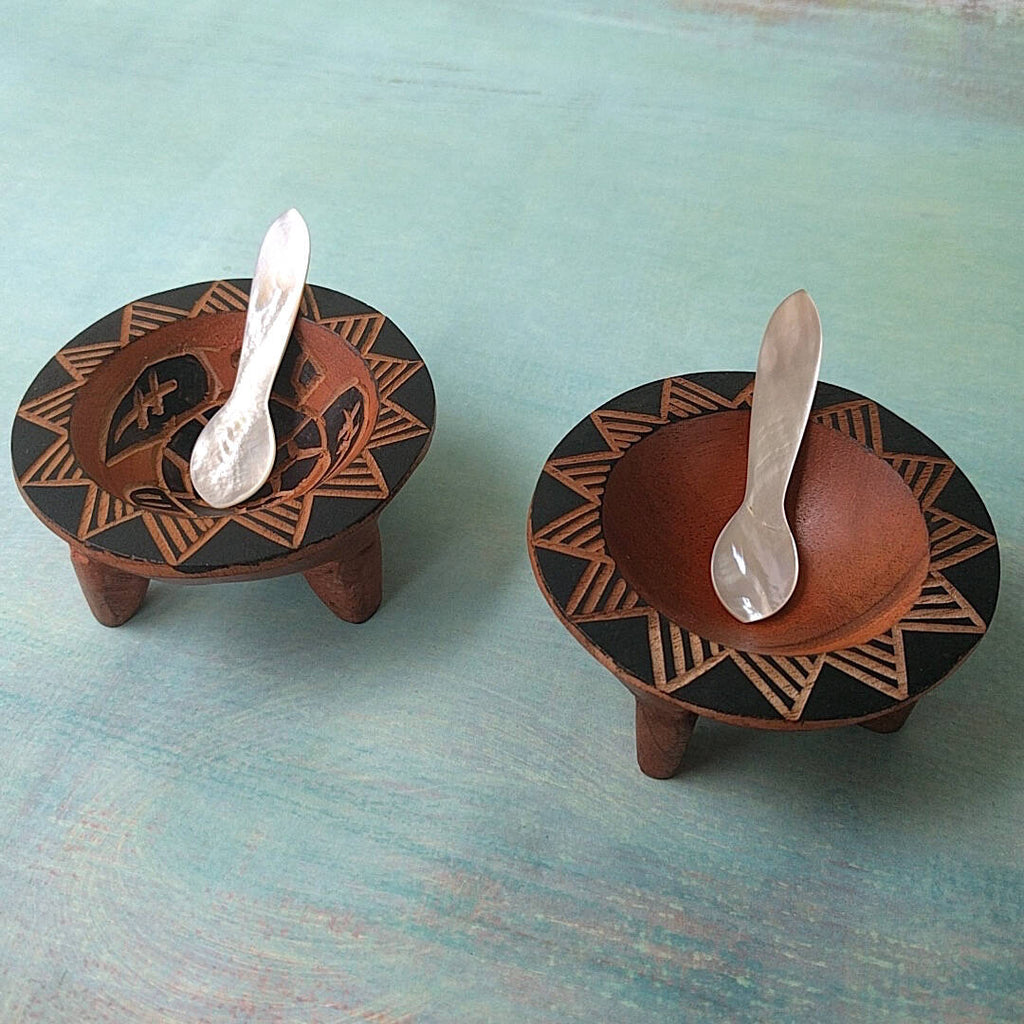 Fijian dark wood salt and pepper empty cellars shown with two mother-of-pearl spoons