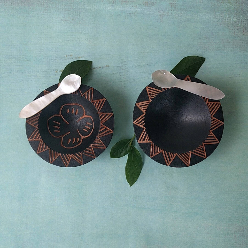 hand carved Fijian dark wood salt and pepper cellars with turtle and sun designs