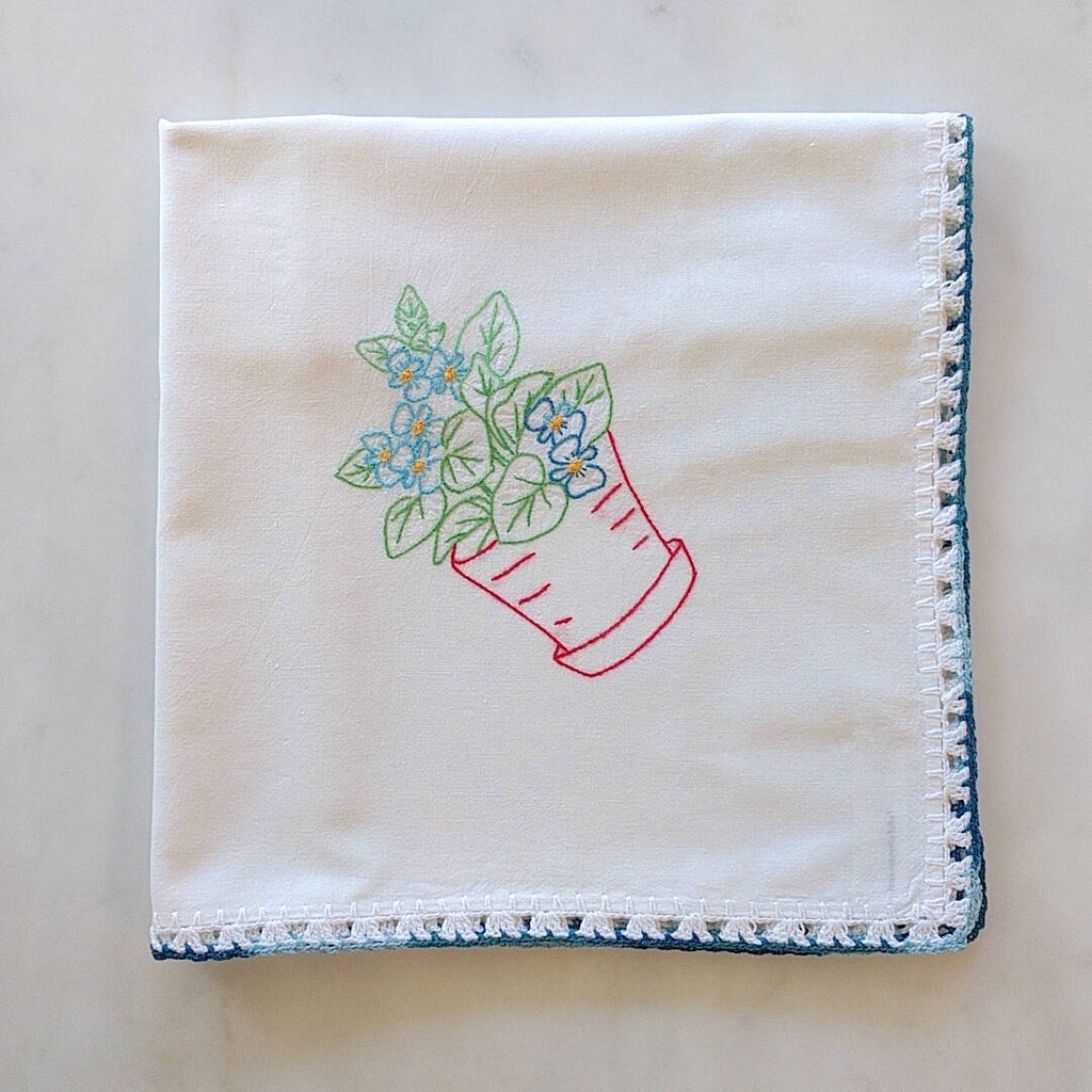 vintage embroidered cotton kitchen towel with red pot and green plant motif