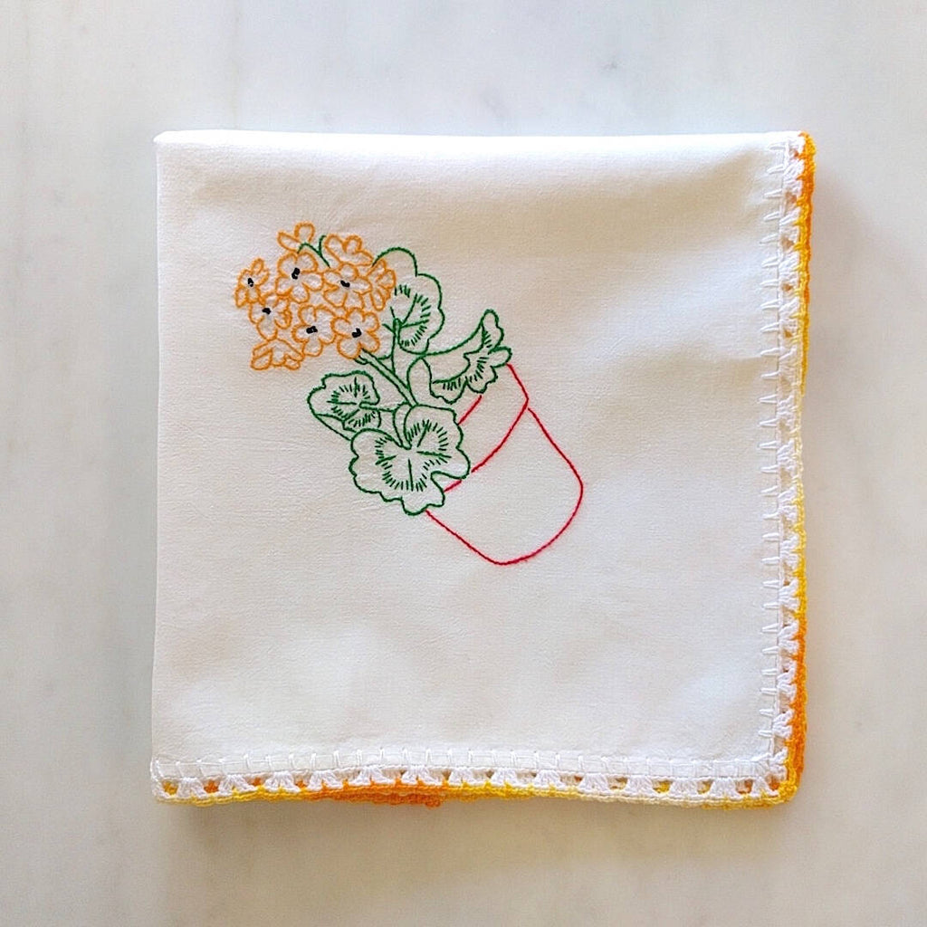 handmade white cotton kitchen towel with red pot and orange flower motif