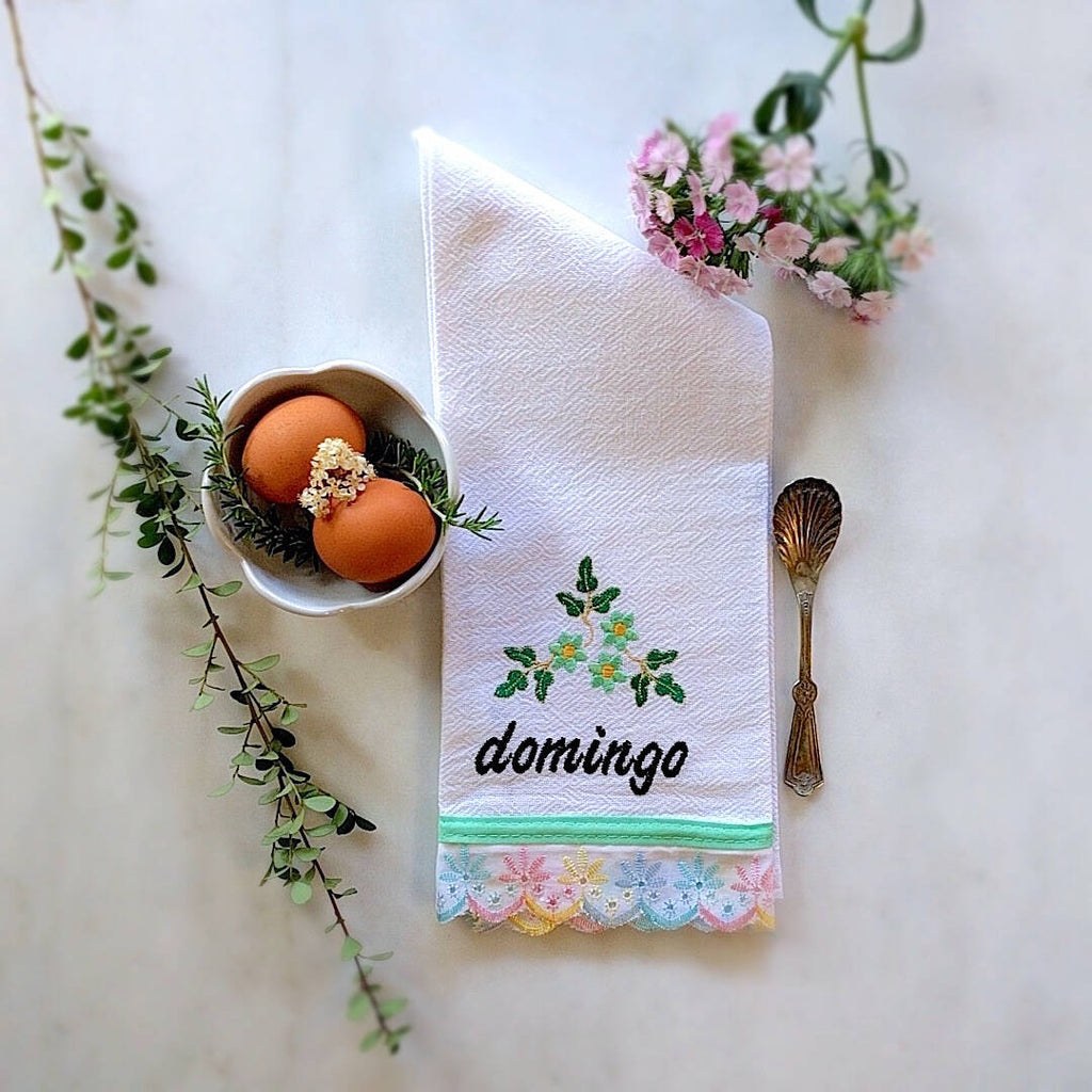 kitchen towel themed with rainbow pastel trim and day of the week: Domingo