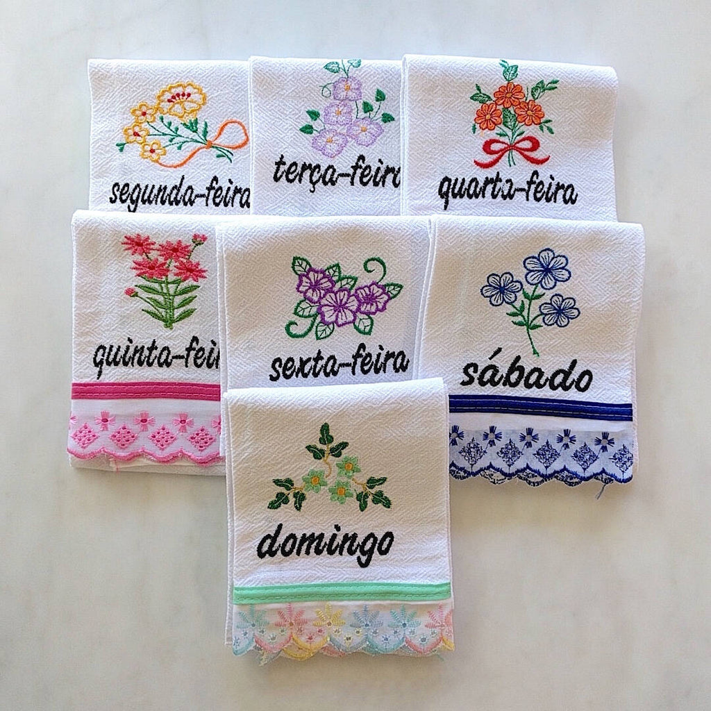 set of 7 cotton kitchen towels colorfully themed after each day of the week in Portuguese