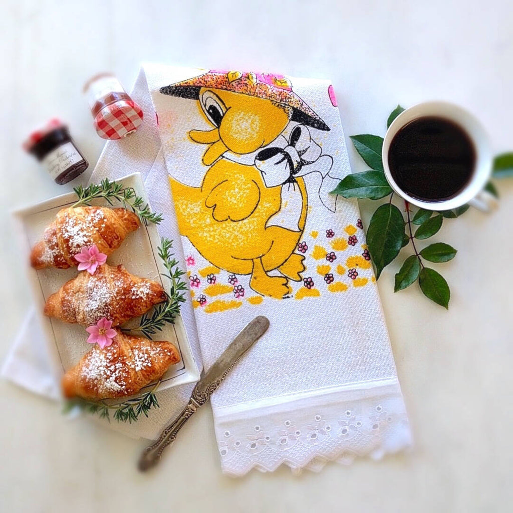 tea towel shown with happy yellow duck theme