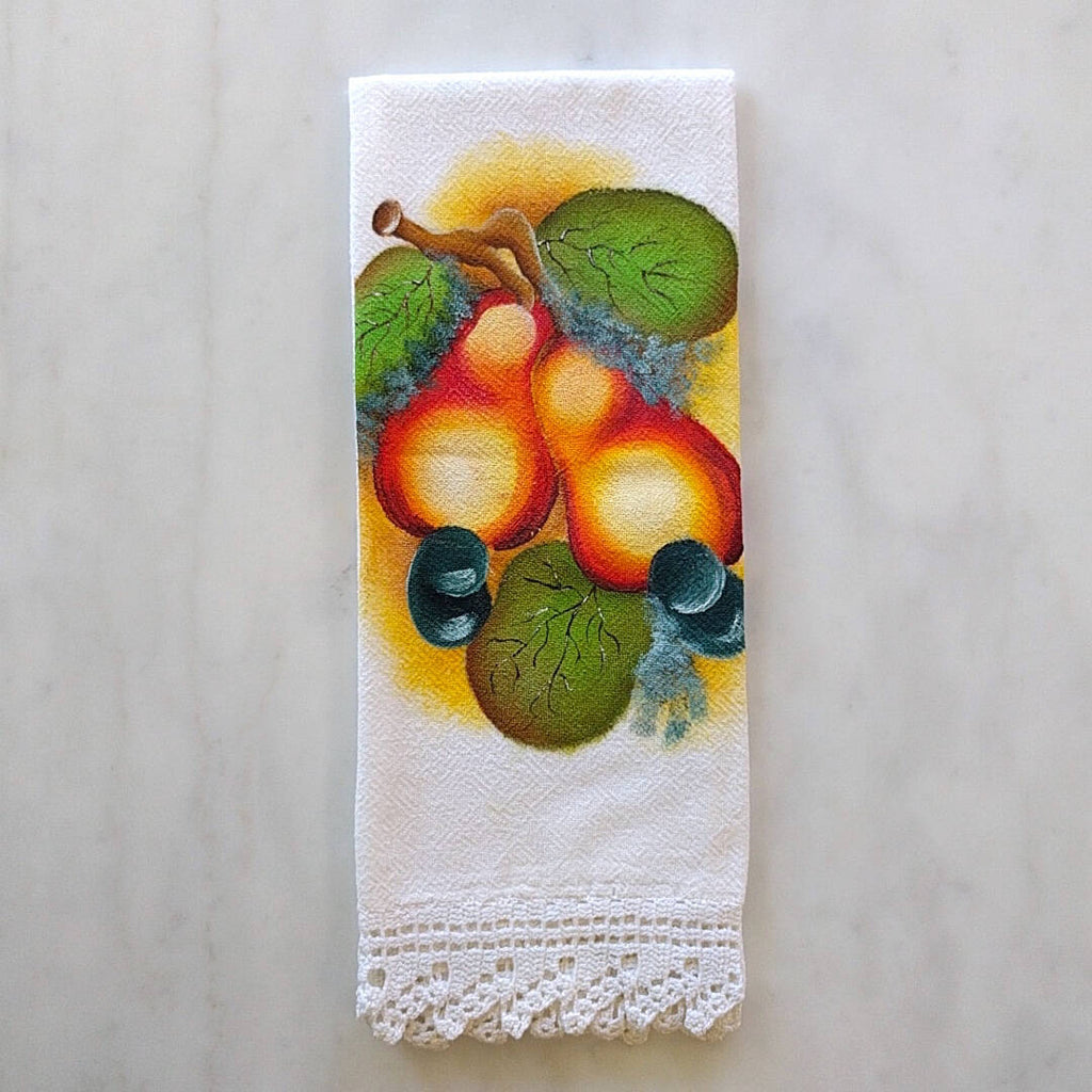 white cotton tea towel with pear motif and a white hand crocheted border