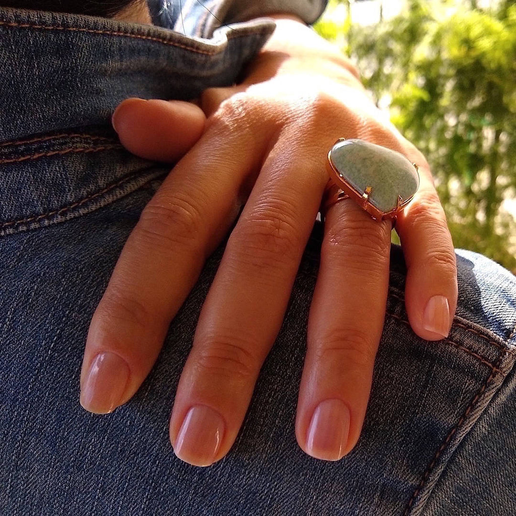 top down view of heart shaped amazonite cocktail ring on a lady's hand