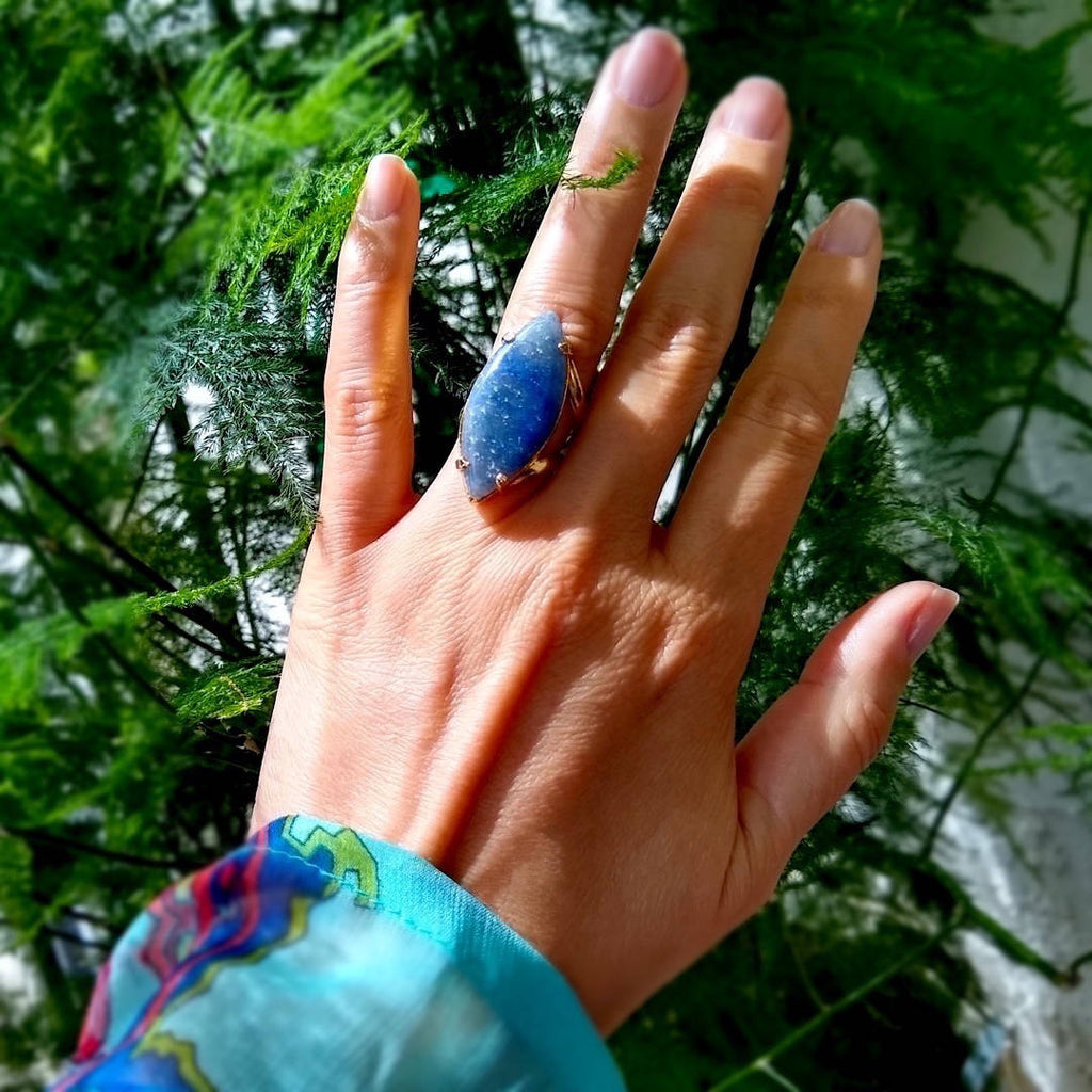 marquise shaped blue quartz cocktail ring on a lady's hand