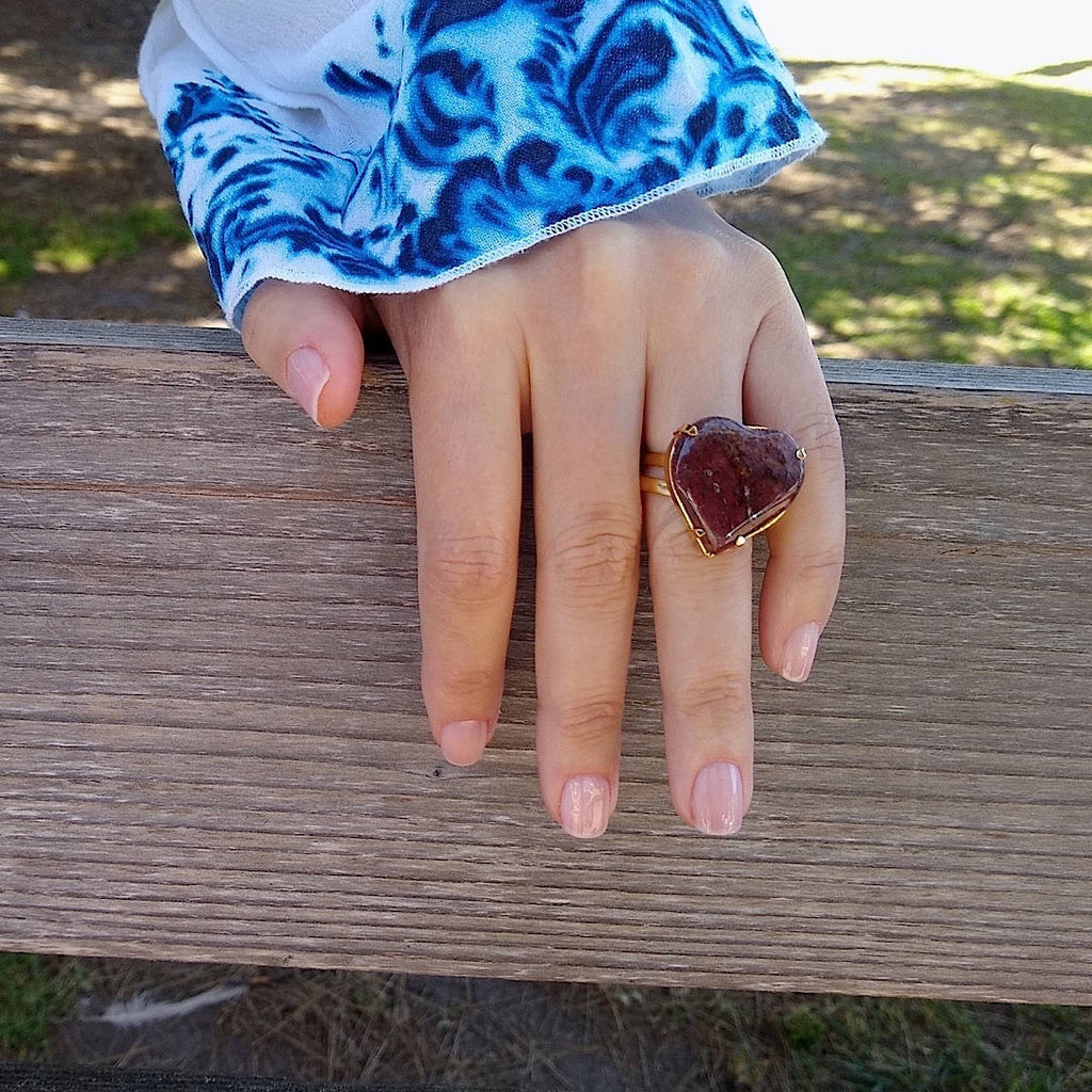 heart shaped dark Jasper cocktail ring on a lady's hand