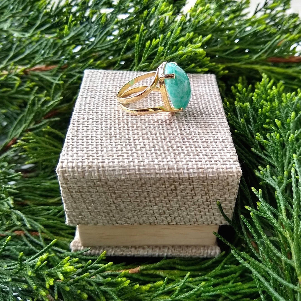oval amazonite ring sitting on top of gift box