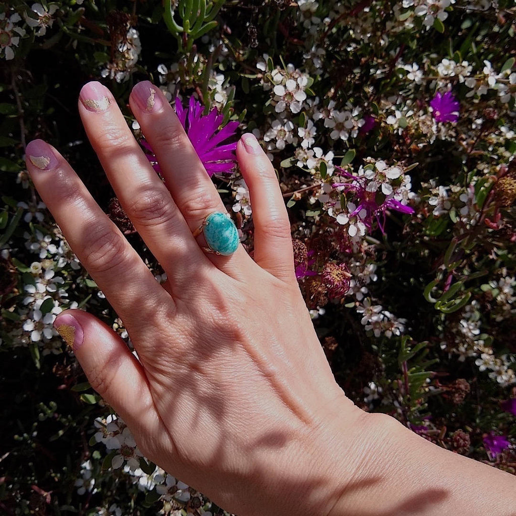 top down view of green amazonite cocktail ring worn on a lady's hand