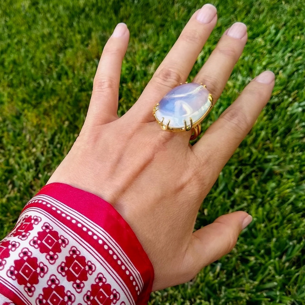 large oval Moonstone cocktail ring on a lady's hand