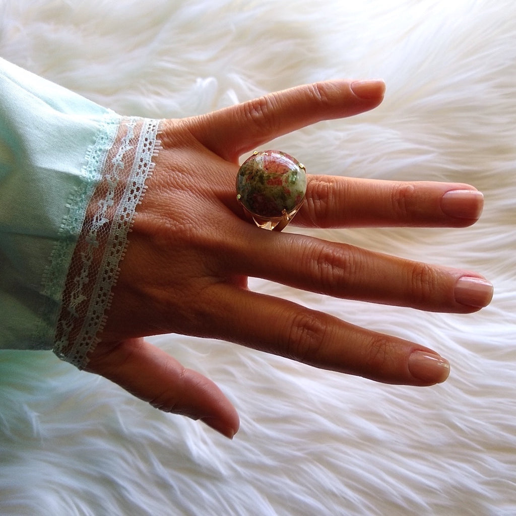 unakite gold-plated cocktail ring with unusual reddish brown color on a lady's hand