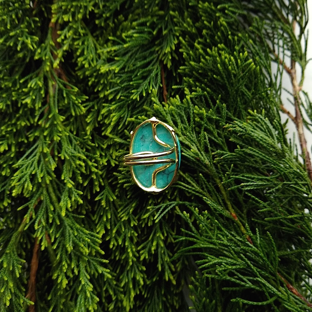 bottom view of oval turquoise adjustable gold-plated cocktail ring