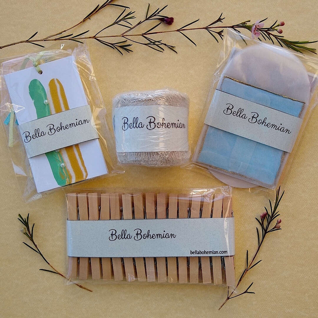 kit contents plastic wrapped: abstract gift cards, linen ribbon, wood clothespins, watercolor cards with glassine envelopes
