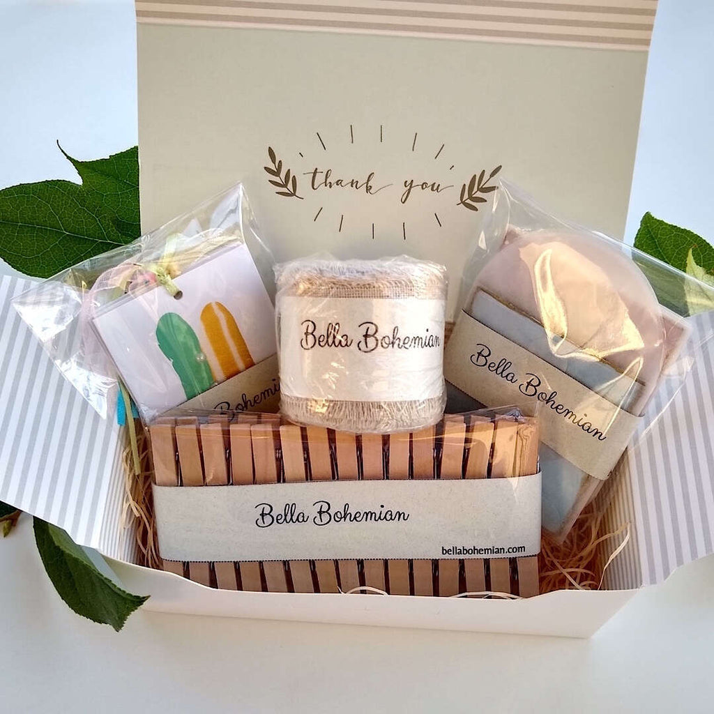 stationary kit with gift tags, linen ribbon, clothespins, glassine envelopes in a gift box, individually wrapped