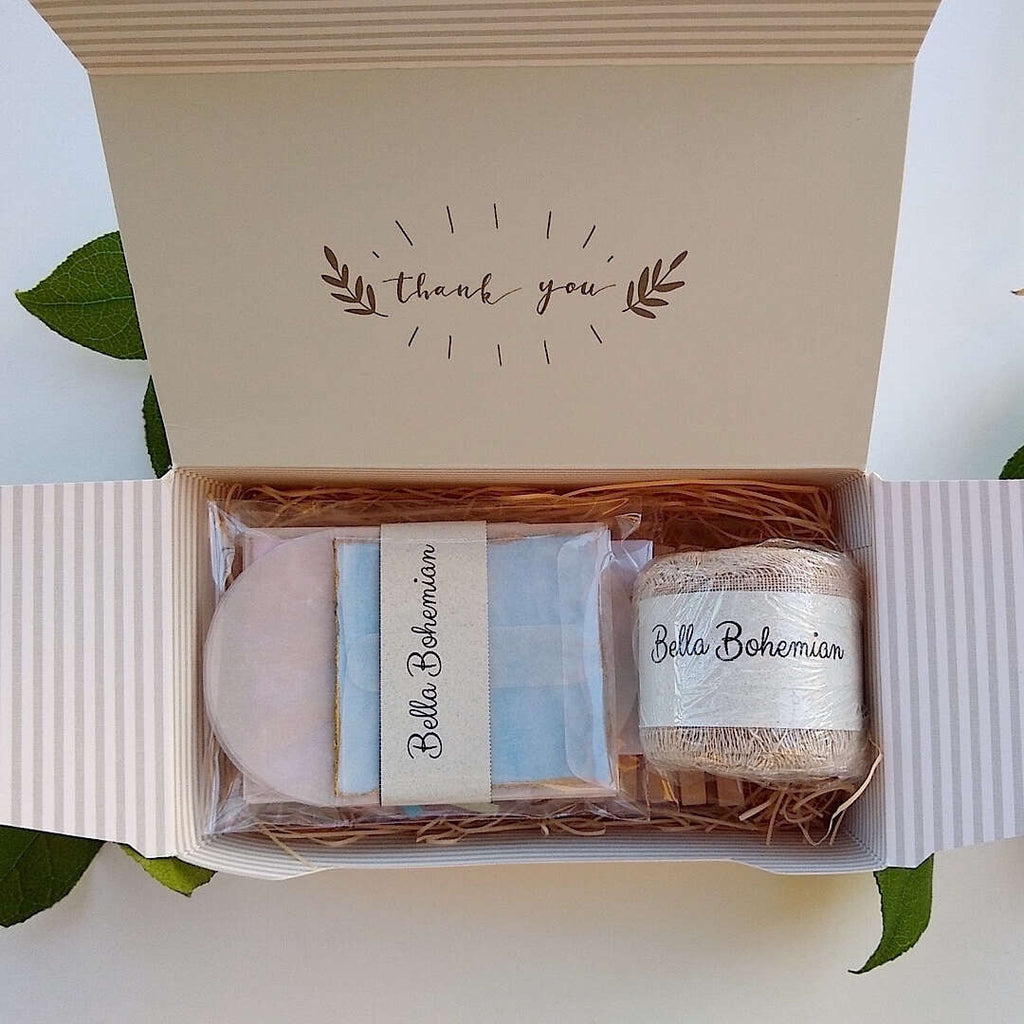 stationary kit with gift tags, linen ribbon, clothespins, glassine envelopes individually wrapped in a thank you gift box
