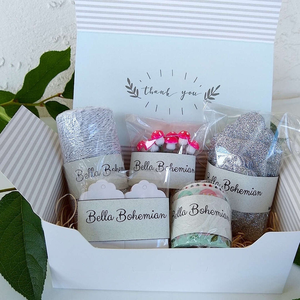 silver luxe glitter gift cards, white hang tags, German cotton spun mushrooms, metallic glitter bakers twine, plastic wrapped standing in gift box